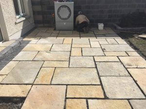 New Limestone Patio with Roll-Out Turf in Dublin